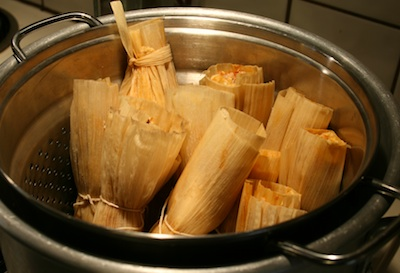 Tamales with goat cheese, chicken, chicken broth, poblanos, red chiles, masa